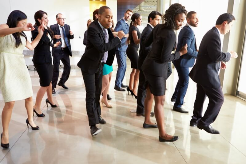 IMG: group of business people dancing