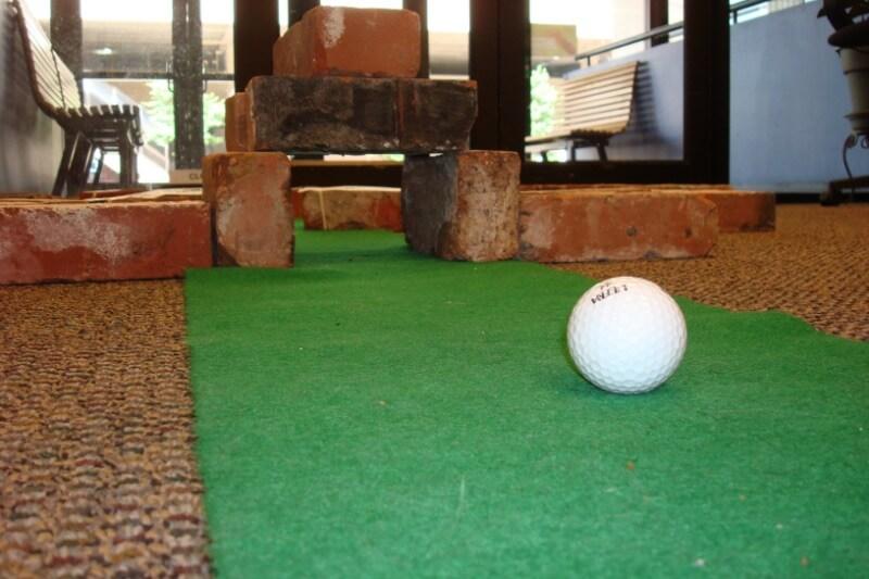 IMG: golf ball on putt putt green