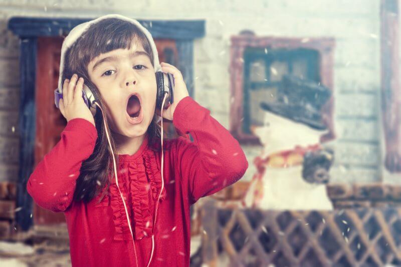 IMG: girl wearing headphones and singing