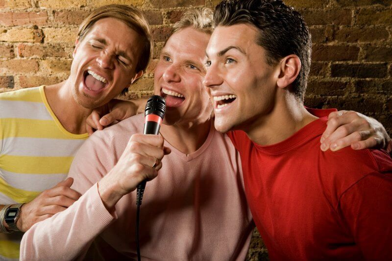 IMG: three men singing karaoke