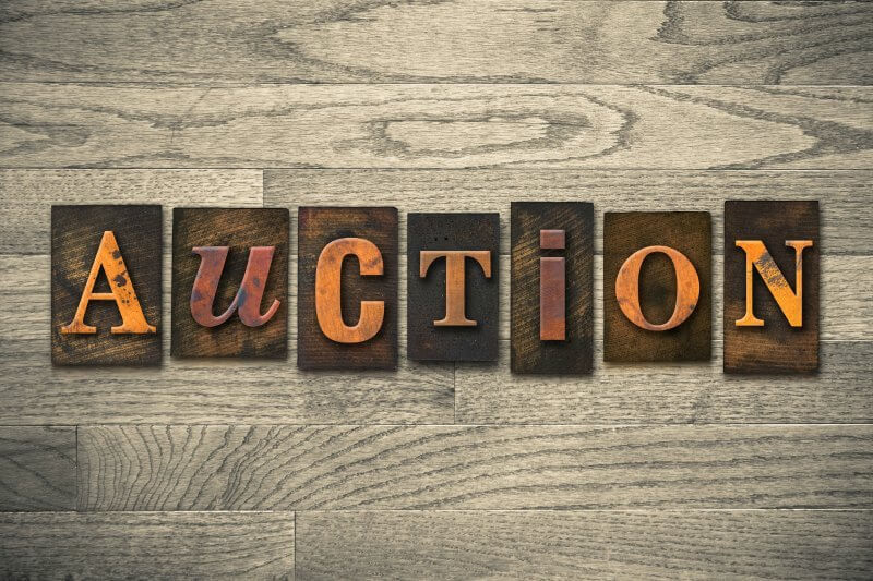 IMG: antique-looking auction sign