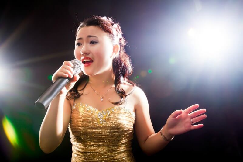 IMG: singing asian woman